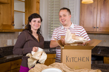 Photo of couple packing as they have sold their home